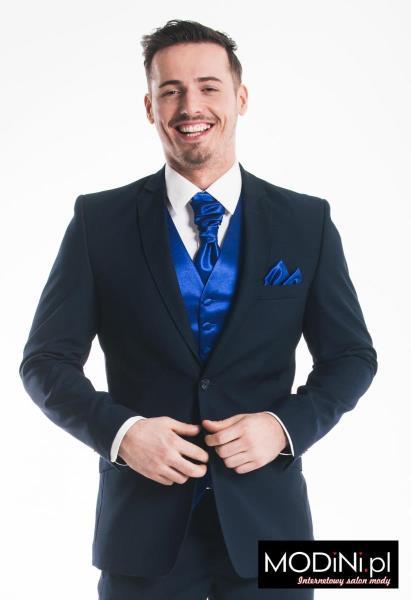 31b495867e214 Garnitur, czyli jedno z najbardziej eleganckich i wizytowych ubrań męskich,  jest doskonały również na ślub. Garnitur weselny powinien składać się z  trzech ...